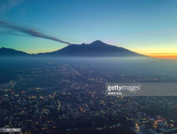 batu malang sunrise from aerial view with citylight - east java province stock pictures, royalty-free photos & images
