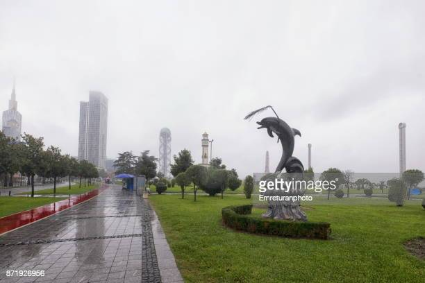 batumi seaside promenade view on a rainy and foggy autumn day - emreturanphoto stock pictures, royalty-free photos & images