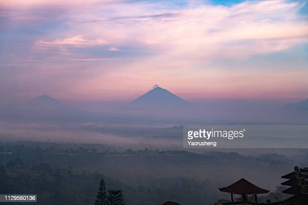 batur volcano and agung mountain panoramic view at sunrise , bali, indonesia - kintamani district stock pictures, royalty-free photos & images