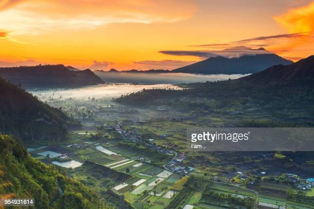 batur volcano sunrise, bali indonesia. batur volcano sunrise serenity, bali. batur sunrise, bali. bali sunrise serenity. dawn sky at morning in mountain. serenity of mountain landscape. - kintamani district stock pictures, royalty-free photos & images