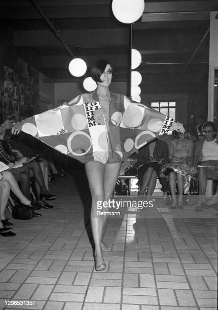 """Batwing sleeves and a neckline slit to below the waist is a Rudi Gernreich message for resort wear. The California designer calls it his """"Batwing..."""