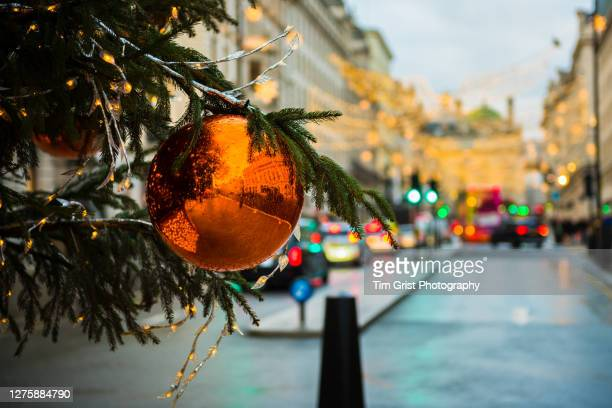 bauble and christmas tree decorations in a london city street - high street stock pictures, royalty-free photos & images