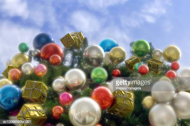 Baubles and miniature gift boxes on Christmas wreath, close-up