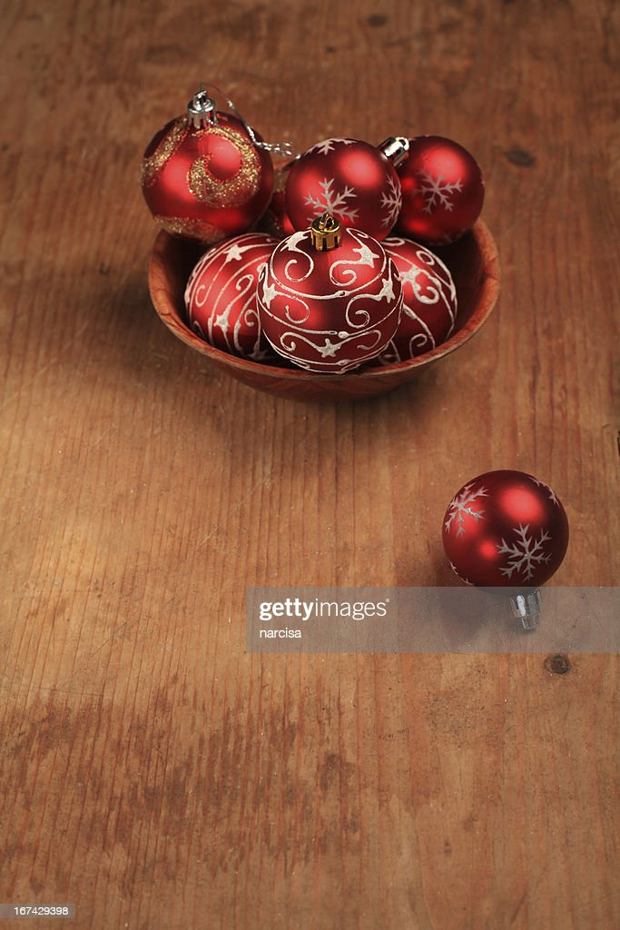 Baubles in a bowl on wooden background : Stock Photo