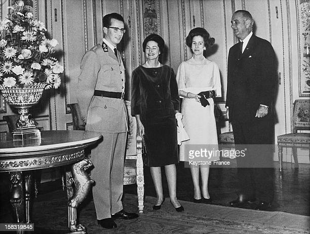 Baudouin I Of Belgium and wife Queen Fabiola Of Belgium with Lyndon B Johnson and wife Lady Bird Johnson at the royal palace of Brussels Belgium...