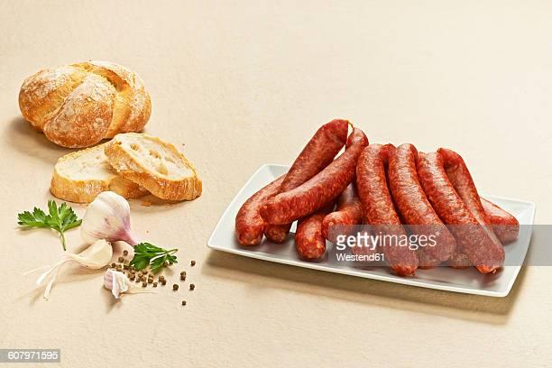 Bauernbratwurst, pork sausages, German raw bratwursts, on plate