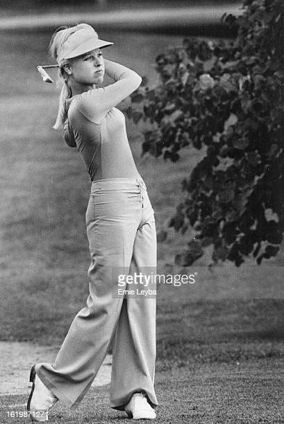 AUG 20 1975 AUG 21 1975 Baugh Laura Individuals Golfer Getting Down To Grim Play At Pinehurst Laura Baugh hits approach shot to third hole Wednesday...