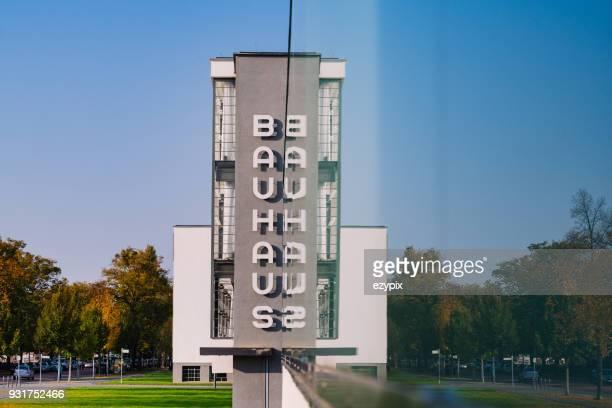 bauhaus dessau sign mirrored - saxony anhalt stock pictures, royalty-free photos & images