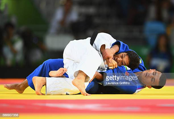 Baul An of Korea and Rishod Sobirov of Uzbekistan compete during the Men's 66kg quarter final on Day 2 of the Rio 2016 Olympic Games at Carioca Arena...