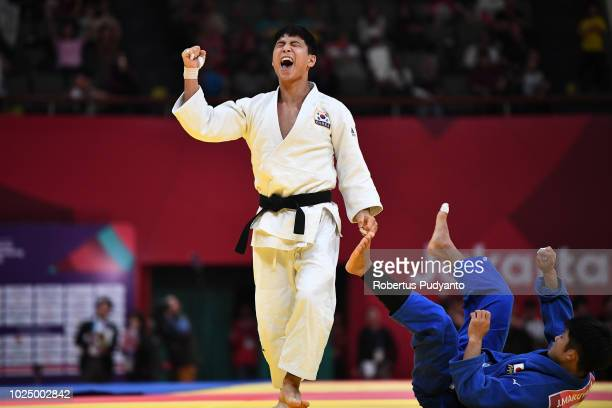 Baul An of Korea celebrates victory after beating Joshiro Maruyama of Japan during Men's Judo 66kg Final at JCC Plenary Hall on day eleven of the...