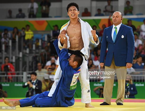Baul An of Korea celebrates victory over Masashi Ebinuma of Japan during the Men's 66kg semi final on Day 2 of the Rio 2016 Olympic Games at Carioca...