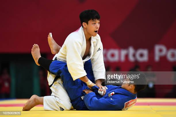 Baul An of Korea fights against Joshiro Maruyama of Japan during Men's Judo 66kg Final at JCC Plenary Hall on day eleven of the Asian Games on August...