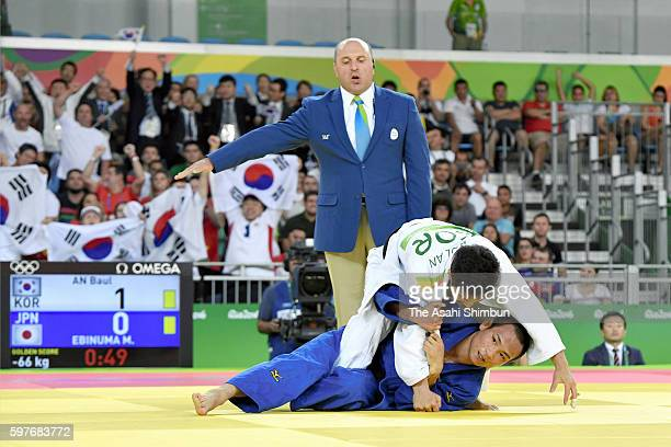 Baul An of South Korea and Masashi Ebinuma of Japan compete in the Men's 66kg semifinal on Day 2 of the Rio 2016 Olympic Games at Carioca Arena 2 on...