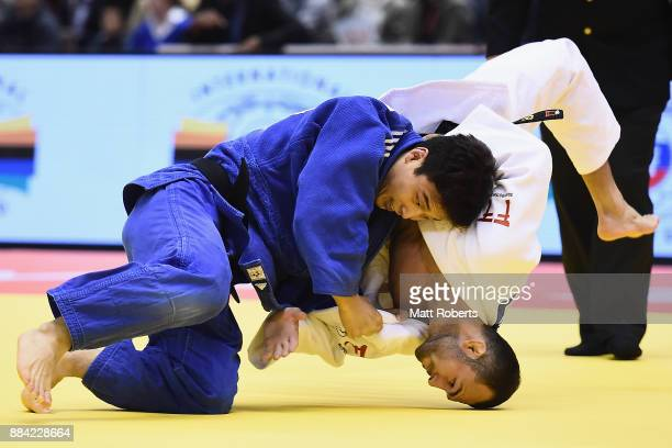 Baul An of South Korea competes against Baruch Shmailov of Israel in the Men's 66kg Bronze Final during day one of the Judo Grand Slam Tokyo at Tokyo...