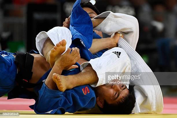 Baul An of South Korea defeats Zhansay Smagulov of Kazakstan during judo action at Rio 2016 on Sunday August 7 2016