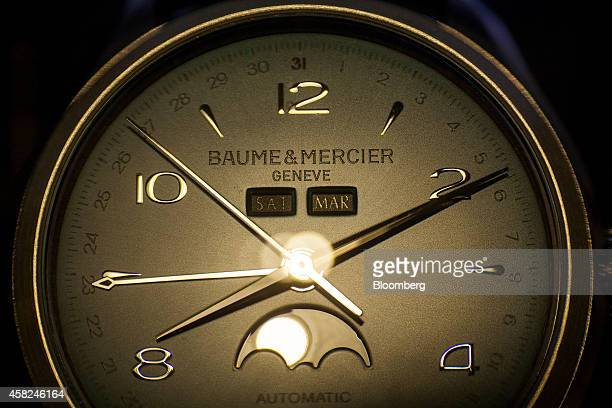 A Baume Mercier SA watch sits on display ahead of Daylight Saving Time at the Tourneau Inc Madison Avenue store in New York US on Saturday Nov 1 2014...