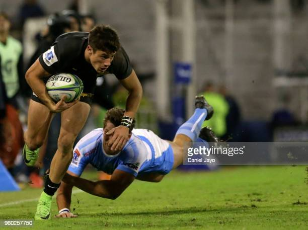 Bautista Delguy of Jaguares is tackled by John Jackson of Bulls during a match between Jaguares and Bulls as part of Super Rugby 2018 at Estadio Jose...