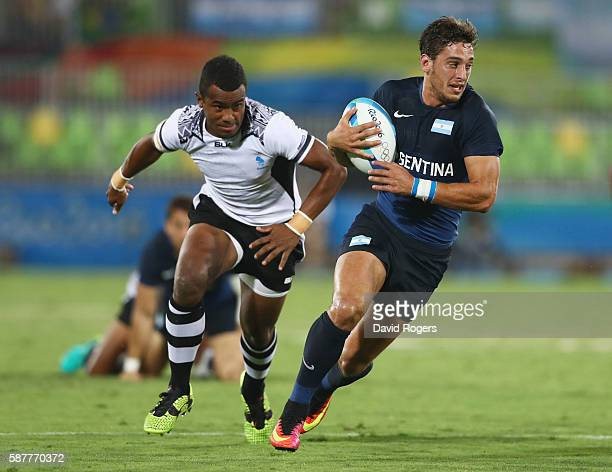Bautista Ezcurra of Argentina breaks through during the Men's Rugby Sevens Pool A match between Fiji and Argentina on Day 4 of the Rio 2016 Olympic...