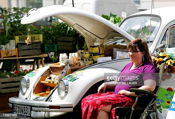 A woman selling beekeepers' products uses the boot of her beetle car to present and sell her products at the weekly market of Bautzen eastern Germany...