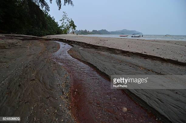 Bauxite contaminated water flows in a small stream at Pantai Pengorak nearby the Kuantan port Most of the empty land area nearby the port are now...