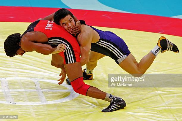 Bauyrzhan Orazgaliyev of Kazakhstan competes with Yogeshwar Dutt of India in the Men's Freestyle 60kg Bronze Medal Match at the 15th Asian Games Doha...