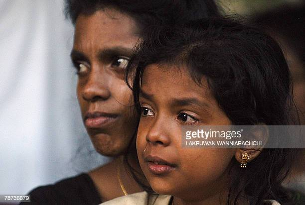 Bavadharani the daughter of Sri Lanka's slain opposition Tamil legislator T Maheswaran sheds a tear at his cremation at the General Cemetery in...