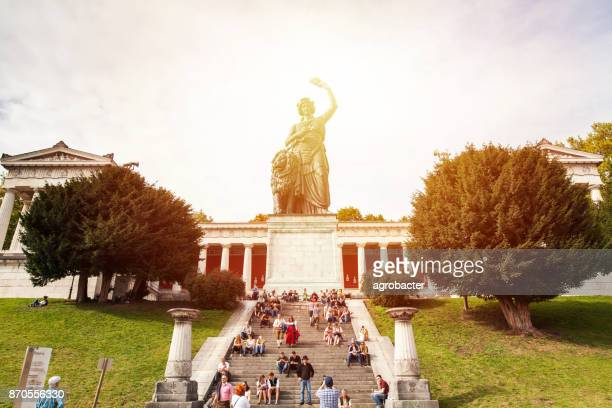 bavaria and feldherrnhalle in munich sky - bavaria stock photos and pictures