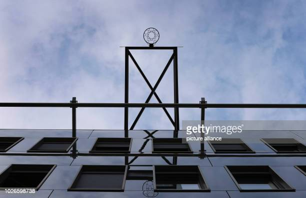A basketball hoop hangs about 20 meters above the fourth floor of a building of the Technical University of Munich The installation is a work of the...