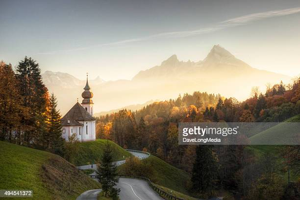bavarian alps with sunset shining on remote church - tyskland bildbanksfoton och bilder