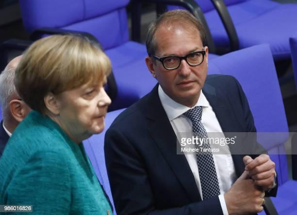 Bavarian Christian Democrats Bundestag fraction leader Alexander Dobrindt looks at German Chancellor Angela Merkel after she gave a government...