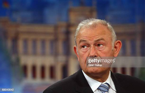 Bavarian Christian Democrats lead candidate Guenther Beckstein prepares to speak in an interview with ARD television in front of a picture of the...