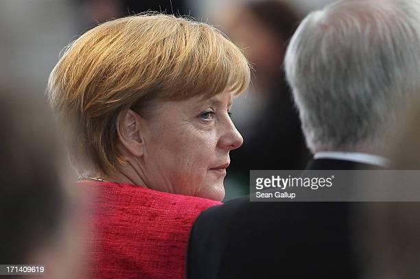 Bavarian Christian Social Union Chairman Horst Seehofer and Chancellor and German Christian Democratic Union Chairwoman Angela Merkel attend a summit...
