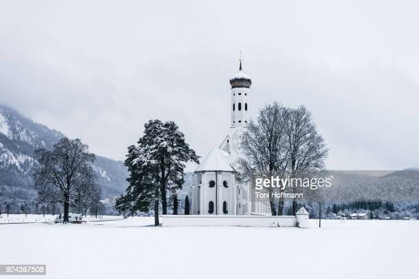 bavarian church st. coloman in a winter landscape - baroque stock pictures, royalty-free photos & images