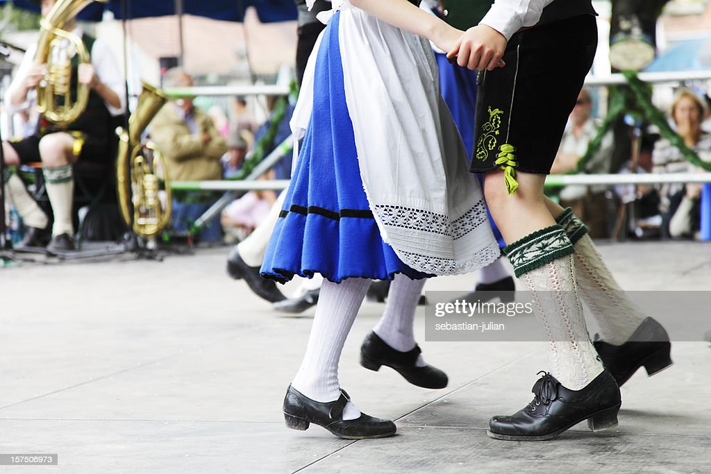 bavarian couple dancing at oktoberfest : Stock Photo