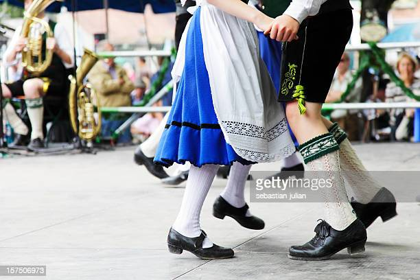 bavarian couple dancing at oktoberfest - germany stock pictures, royalty-free photos & images