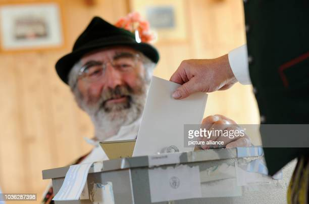 A Bavarian election assistant in traditional clothing is pictured during the European election 2014 in Deining Germany 25 May 2014 Around 400 million...