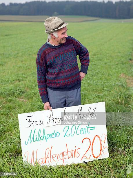 Bavarian farmer protests against plummeting milk prices holding a placard on September 16 2009 near Landsberg am Lech Germany Dairy prices have...