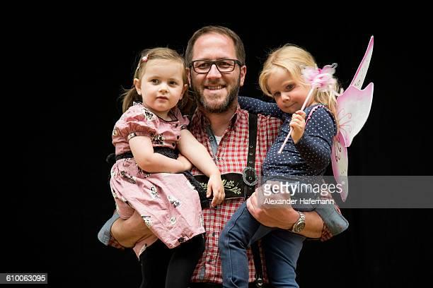 Bavarian Father in Lederhosen with hislittle girls