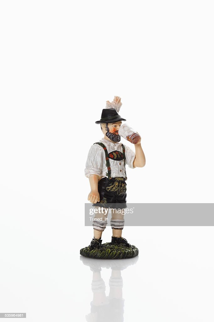 Bavarian figurine drinking beer from beer stein : Stock Photo