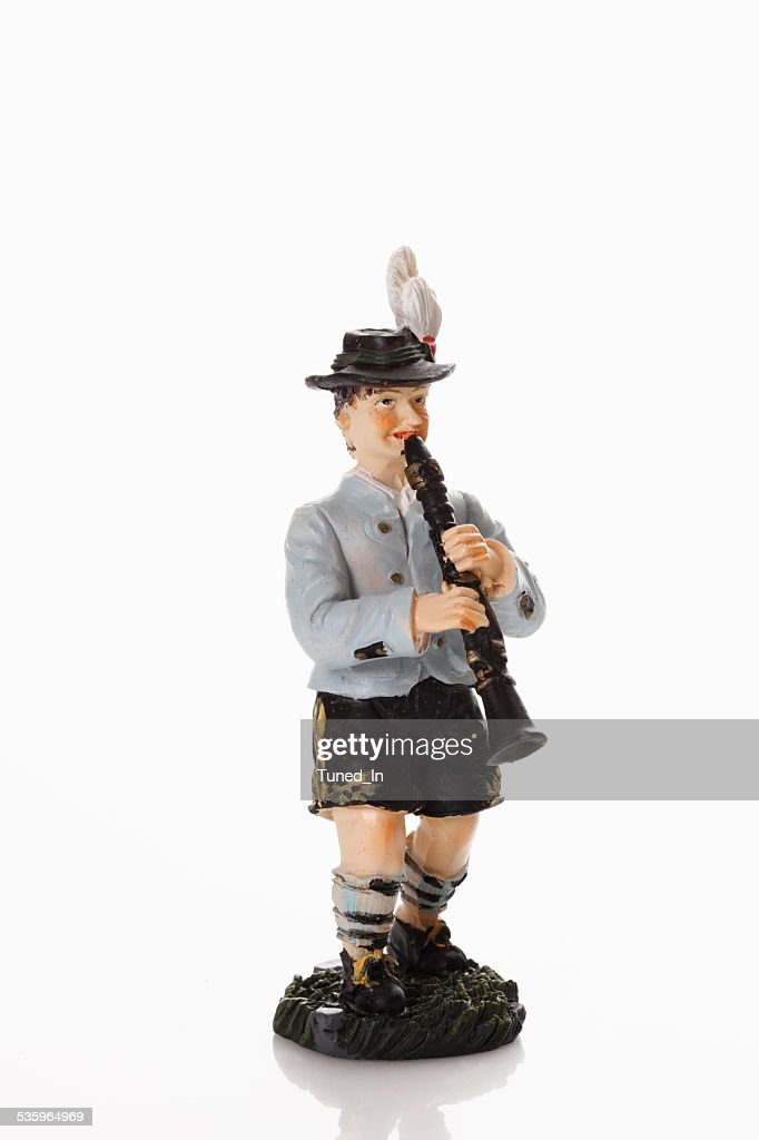 Bavarian figurine playing clarinet on white background : Stock Photo