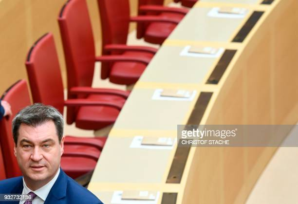 Bavarian Finance Minister and designated Bavarian State Premier Markus Soeder stands in Bavaria's State parliament where he is to be elected as new...