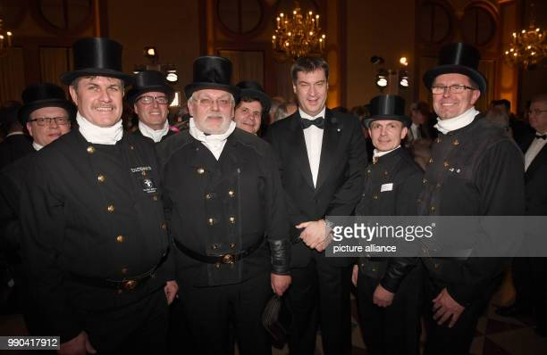 Bavarian Finance Minister and prime candidate for teh state elections Markus Soeder pictured with Kaminkehrern at a New Year reception at the...