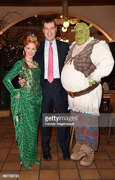 Bavarian Finance Minister Markus Soeder actress Bettina Moench and actor Andreas Lichtenberger attend the 'Shrek Das Musical' Photocall at Hofbraeu...