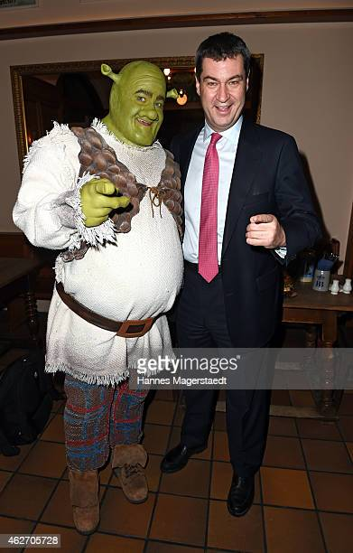 Bavarian Finance Minister Markus Soeder and actor Andreas Lichtenberger attend the 'Shrek Das Musical' Photocall at Hofbraeu Keller on February 3...