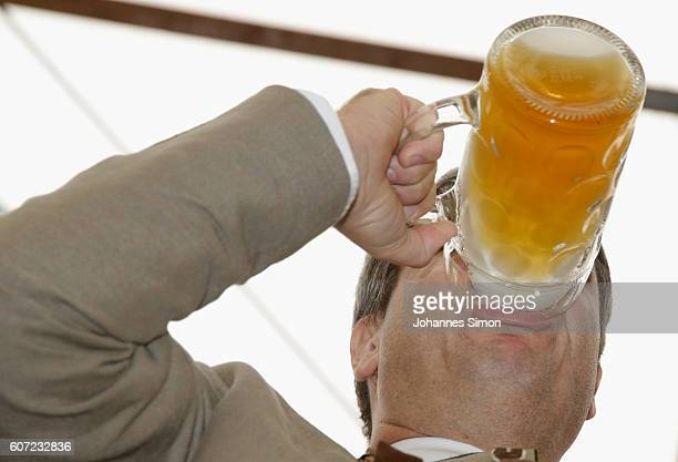 Bavarian finance minister Markus Soeder drinks onelitre mug of beer to kick off the 2016 Oktoberfest beer festival in the Hofbraeu tent at...