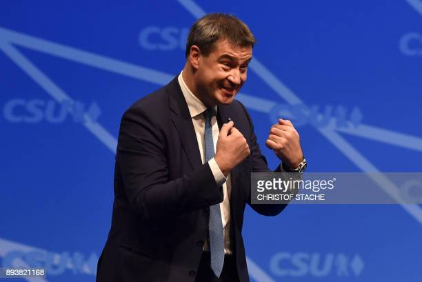 Bavarian Finance Minister Markus Soeder gestures after his speech on December 16 2017 in Nuremberg southern Germany during the congress of their CSU...