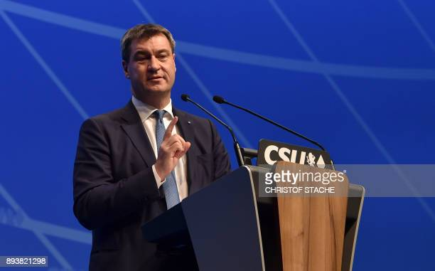 Bavarian Finance Minister Markus Soeder gestures during his speech on December 16 2017 in Nuremberg southern Germany during the congress of their CSU...