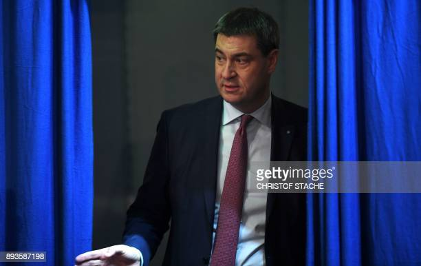 Bavarian Finance Minister Markus Soeder leaves the congress hall on December 15 2017 in Nuremberg southern Germany during the congress of the CSU...