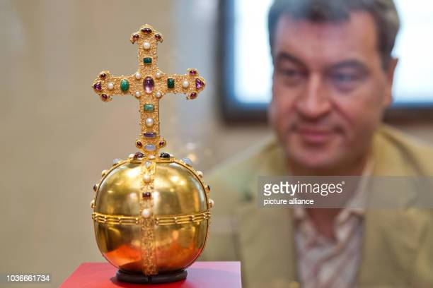 Bavarian finance minister Markus Soeder looks at the replica of a golden orb in Kaiserburg castle in Nuremberg Germany 11 July 2013 After several...