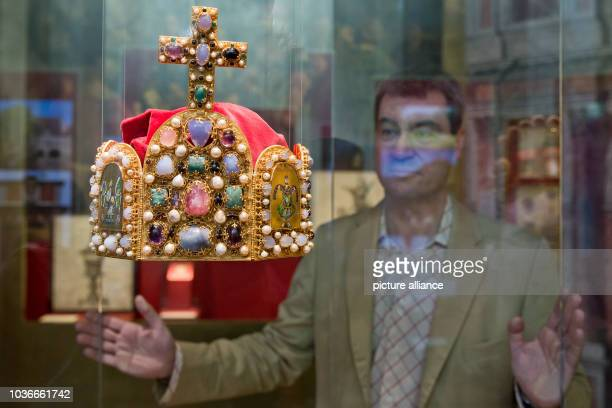 Bavarian finance minister Markus Soeder looks at the replica of an imperial crown in Kaiserburg castle in Nuremberg Germany 11 July 2013 After...